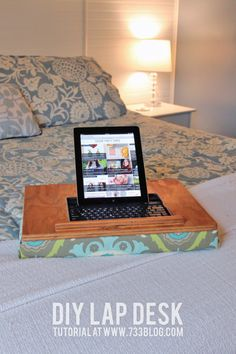 Make your own lap desk! It's sturdy, and you can pick out your favorite fabric :-)
