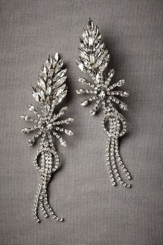 Firespark Earrings at B H L D N | A flame of marquis-cut crystals bursts above a pave-set loop and a triple tassel. From Erickson Beamon. Sterling silver vermeil, Swarovski crystals, chain fringe.  So inspiring and bridal!
