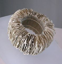Bracciale Millefoglie (Bracelet of A Thousand Leaves) by Eileen Wallace, 2008 x individually pulled sheets of handmade flax and cotton paper with a bamboo clasp and sewn coptic link stitch Paper Earrings, Paper Jewelry, Paper Beads, Jewelry Art, Jewelry Design, Paper Art, Paper Crafts, Ouroboros, Bracelets