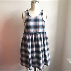Plaid flannel babydoll dress, grunge size XS Cutest little plaid flannel baby doll dress size extra small. Cute edges with unique hem. I only wore this one time, and I got tons of compliments. I wore it with black tights and doc Martens, and a velvet choker. Super grunge! Somedays Lovin Dresses