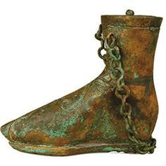 Silver, bronze and iron. Bronze balsamarium in the form of a foot. Roman, Balkan region, circa 2nd-3rd century AD. D Bronze foot shod with calceus. Chain through two side lugs.