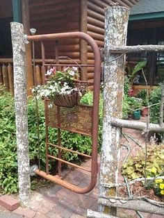 Dishfunctional Designs: The Upcycled Garden June Volume 4.   old metal headboard as garden gate -- I think I am going to have to do this