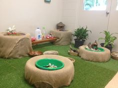 """Hessian-covered tyres at Penguin Childcare ("""",) Love the tire idea. The artificial turf, not so much."""