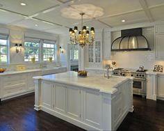 Another beautiful white kitchen with dark stained Oak hardwood floors.
