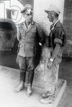 Credit: Erwin Rommel in conversation with a soldier from the African Corps in the captured city of Tobruk, Libya, June 1942 (b/w photo), German Photographer, (20th century) / © SZ Photo / Scherl / The Bridgeman Art Library