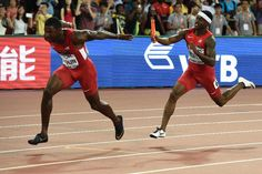 "USA's Trayvon Bromell (R) hands the baton to USA's Justin Gatlin (L) in the final of the men's 4x100 metres relay athletics event at the 2015 IAAF World Championships at the ""Bird's Nest"" National Stadium in Beijing on August 29, 2015 (AFP Photo/Franck Fife)"