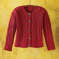 This cozy merino wool sweater is a virtual sampler of Irish Aran knitting patterns. Each pattern symbolizes an aspect of local fishing culture: Celtic rope for Irish pride; fisherman's cable for safety on the waters; basket stitch for a plentiful catch; and diamond, the shape of a fishing net, for success. The warm wool is renowned for its extremely soft hand, providing warmth and comfort without the itch of lower-quality fibers.