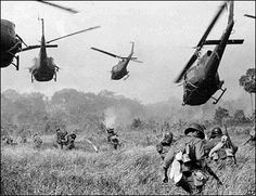 Hovering Us army helicopters pour machine gun fire into the tree line to cover the advance of South Vietnamese Ground troops in an attack on a Viet Cong Camp 18 miles north of Tay Ninh, Vietnam, Northwest of Saigon near the Cambodian Border Vietnam War Photos, Vietnam History, South Vietnam, Vietnam Tours, War Photography, Photography Ideas, Cold War, World History, History Books