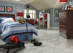 Enjoy carefree maintenance and get the authentic look of solid hardwood with Dunes Bay Driftwood from Dream Home. The distinctive whitewashed finish features light gray, white, and beige hues complemented by the appearance of weathered graining.