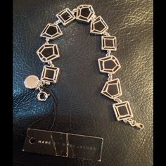 Marc Jacobs Silver and Black Enamel Bracelet This is beautiful! Shiny silver trim and black enamel with fun angled shapes. Very light weight. Marc Jacobs new with tag. Marc Jacobs Jewelry Bracelets