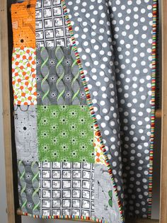 This adorable, unique baby quilt is completed and ready to ship to you! It features a fun, science theme with images of the periodic table, atoms,