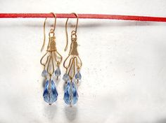 Blue crystal earrings. Wire wrapped earrings. Gold by MADAMBLUEONE, $30.00