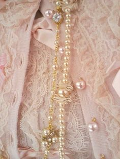 Lovely pink lace sweater with pearls.....