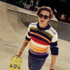 Sweater, $990, Saint Laurent by Anthony Vaccarello / Jeans, $248, by Citizens of Humanity / Sunglasses by Victoria Beckham / Watch strap by J.Crew / Watch by Avant by South Lane / Sneakers by Saint Laurent by Anthony Vaccarello / Skateboard, his own / Location: Cantelowes Skatepark, London