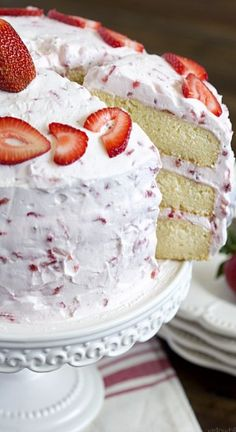 Fresh Strawberry Cake ~~~ A rich, moist vanilla pound cake is divided into three layers, and slathered with the most light and fluffy whipped cream and cream cheese frosting, overflowing with fresh strawberries. It's a light yet filling treat that's perfect for summer.