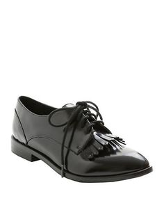 Borrowed-from-the-boys fashion at its finest, these leather-like oxfords are defined by fringed details and a glassy finish.