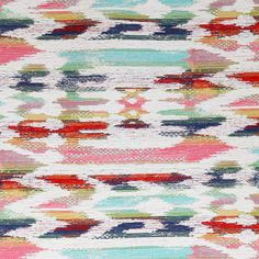 A multi-coloured boho inspired upholstery fabric in candy pink, turquoise, navy blue, grass green, saffron yellow and orange-red and cream. Suitable for upholstery, cushions, pillows and other home decor accessories.