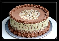Now that's how you decorate a banana cake! My first try at chocolate lace. banana cake with real chocolate buttercream and white chocolate lace and almonds on top. mmm yum