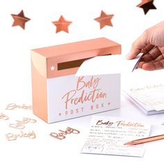 This Ginger Ray Rose Gold Baby Prediction Box features a 'Baby Prediction Post Box' headline on it and a slot to insert the included cards. Guests can guess the weight of the baby, what the baby will grow up to be, and more with this prediction box! Juegos Baby Shower Niño, Décoration Baby Shower, Baby Shower Roses, Cadeau Baby Shower, Fun Baby Shower Games, Baby Shower Party Supplies, Kids Party Supplies, Baby Games, Baby Shower Parties