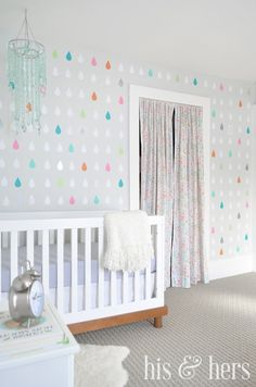 love the colorful raindrop wall for a baby room!