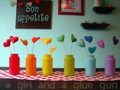 Love the colorful jars. Color glass jars - great idea for a rainbow party