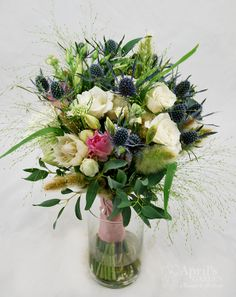 a very wild and rustic bridal bouquet! Flowers by April's Garden in Durango,CO http://www.durangoflorist.com/