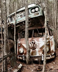 VW Bus with Truck Stacked on top in Trees
