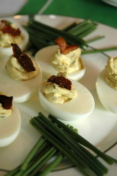 Bourbon Bacon Deviled Egg Recipe from AnAppealingPlan.com. Perfect for a Kentucky Derby Party or to bring to a neighbors BBQ. @KraylFunch
