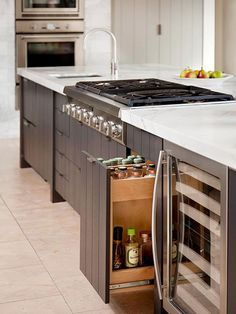 Where will spices and oils go in new kitchen if cooktop is in an island?