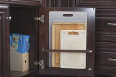Cutting board storage on inside door of lower cabinets.