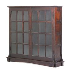 "GUSTAV STICKLEY; Extremely rare early bookcase with mitered mullions and Gothic panes, Eastwood, NY, ca. 1901; Unmarked; 53 1/2"" x 56"" x 13 1/4""; Provenance: William Jenack Estate Auctions Mostly excellent original finish and dark early color with normal wear commensurate with age and use. A few small chips. Minor looseness, opening to seam on top. The base of this bookcase has been replaced. Six adjustable shelves. Sale Price: $11,250 Estimate: $12,000 - $18,000"