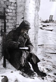 Soviet soldier writes a letter in Stalingrad
