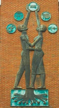 Students Aspire, (sculpture)  Catlett, Elizabeth, 1915- , sculptor  Located at Howard University, 2300 6th Street, N.W., building facade, Washington, District of Columbia
