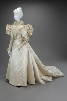 """Wedding dress, American, late 1890s. Silk satin & chiffon. Likely inspired by a """"promenade costume"""" by Worth that was published in Harper's Bazaar in 1896."""