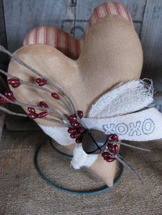 Primitive heart make do on rusty bed spring with rusty bell. Cute for valentines day