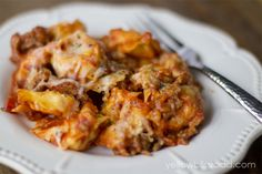 Skillet sausage and cheese tortellini...I will cook pasta on the side, gets too starchy when cooked in skillet.