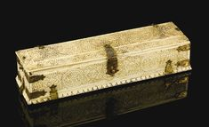 A carved ivory penbox, South India or Sri Lanka, 18th century the ivory carved in relief with roundels containing floral motifs, with symmetrical foliate designs in between and gilt copper hinges, the interior with two compartments and a removable tray