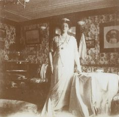 Alexandra in her cabin on the Standart, 1912. Note the picture of Alexei on the wall to the right