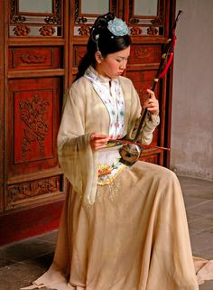 Woman playing Erhu in China by ljbeau.deviantart.com on @deviantART.  Young woman playing Erhu instrument in Suzhou gardens.  The Erhu is a two stringed, violin-like instrument, which produces some very beautiful music.