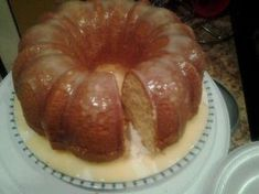 Easy homemade pound cake recipe made from an old fashioned recipe that's simple to make with only 4 ingredients! Make this bundt pan pound cake that is moist, dense and absolutely delicious! Köstliche Desserts, Delicious Desserts, Dessert Recipes, Food Cakes, Cupcake Cakes, Cupcakes, Cream Cheese Pound Cake, Bunt Cakes, Brownie