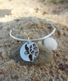 See Turtle Conservation Sand Dollar Silver by SophieJadeJewellery. 40% of the proceeds from this item go towards helping protect sea turtles! What's not to love!?