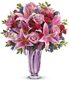 Teleflora's Lavender Grace Bouquet of Mother's Day flowers in a keepsake lavender glass vase.