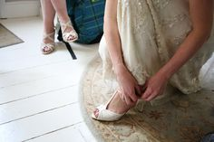 putting shoes on, the bride on her wedding day in essex, Jenny Packham wedding dress, documentary wedding photography