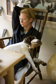 Tilda and her doggie.  Didn't think it was possible to love this woman more...and she loves dogs too?  Swoon!