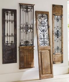 Vintage Gate Artwork: Our Vintage Gates artwork is crafted from generously distressed wood and metal. The rustic wooden frames and inset finials resemble found artifacts that are sure to complement most any decor. Decor, Old Doors, House Design, Wood And Metal, Door Design, Wrought Iron Decor, Home Decor, Iron Decor, Tuscan Decorating