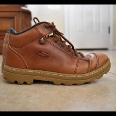 Sketchers hiking boots Really comfortable leather hiking boots. I wore them for hiking, school and just everyday things. Boy size 5 which is a 7 in women. Kept in great condition. I would say a 8/10. Not waterproof Skechers Shoes Combat & Moto Boots