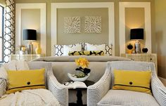 Remove hardware from dresser and armoire replace with black. Recover queen Ann chairs with a black/white fabric, black and cream curtains yellow accents and pillows. White trims, light walls