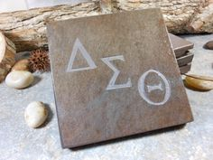 Carved Slate Coasters - Delta Sig Sorority.  Personalized Drink Coasters.  Contact me about your design at BlythHouseCreations.com Slate Coasters, Drink Coasters, Coaster Design, Sorority, Over The Years, Place Cards, Carving, Place Card Holders, Gallery