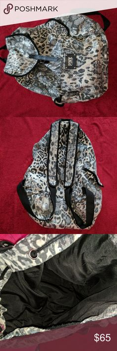 Victoria's Secret Sequin Leopard Print Bakpack Selling a super cute black and white sequin leopard print backup. It's pretty spacious and can hold a lot! Opens and closes with a drawstring and buckle flap, straps are adjustable. In excellent condition! Only used it once or twice. PINK Victoria's Secret Bags Backpacks