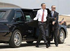 A Secret Service agent readies the new presidential limousine that ...